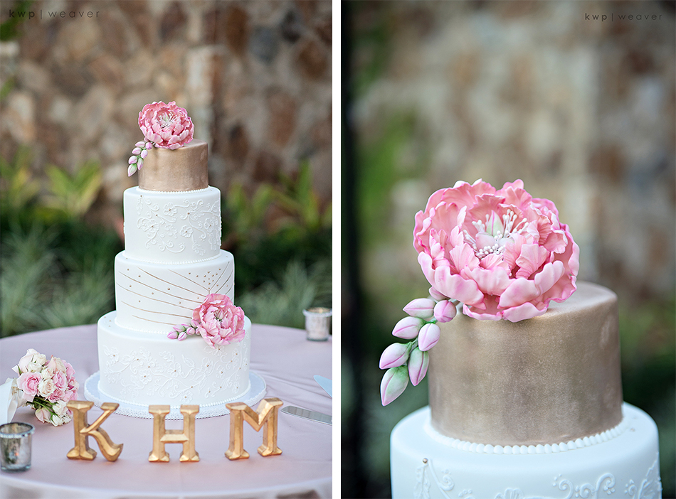 Gold wedding cake with pink sugar flowers