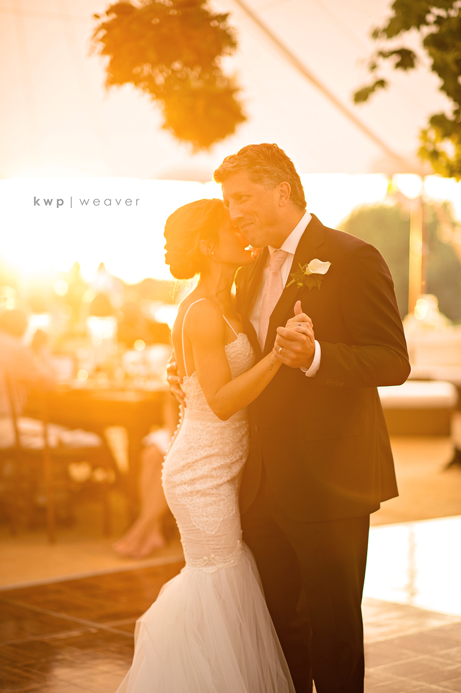 bride and brother sunset dance