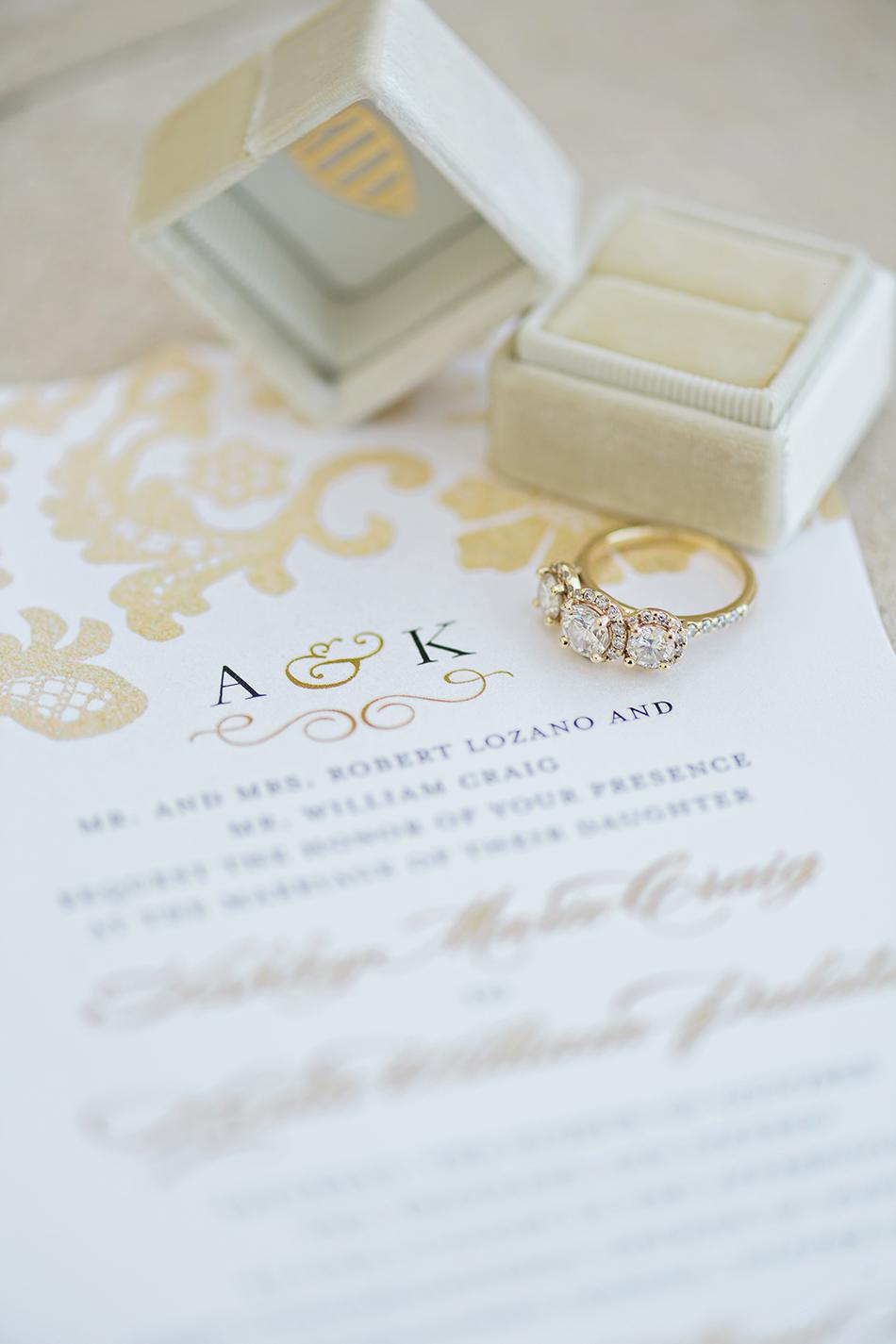 Gold monogrammed wedding invitation