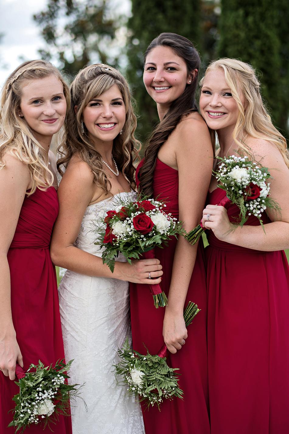Bridesmaids wearing red