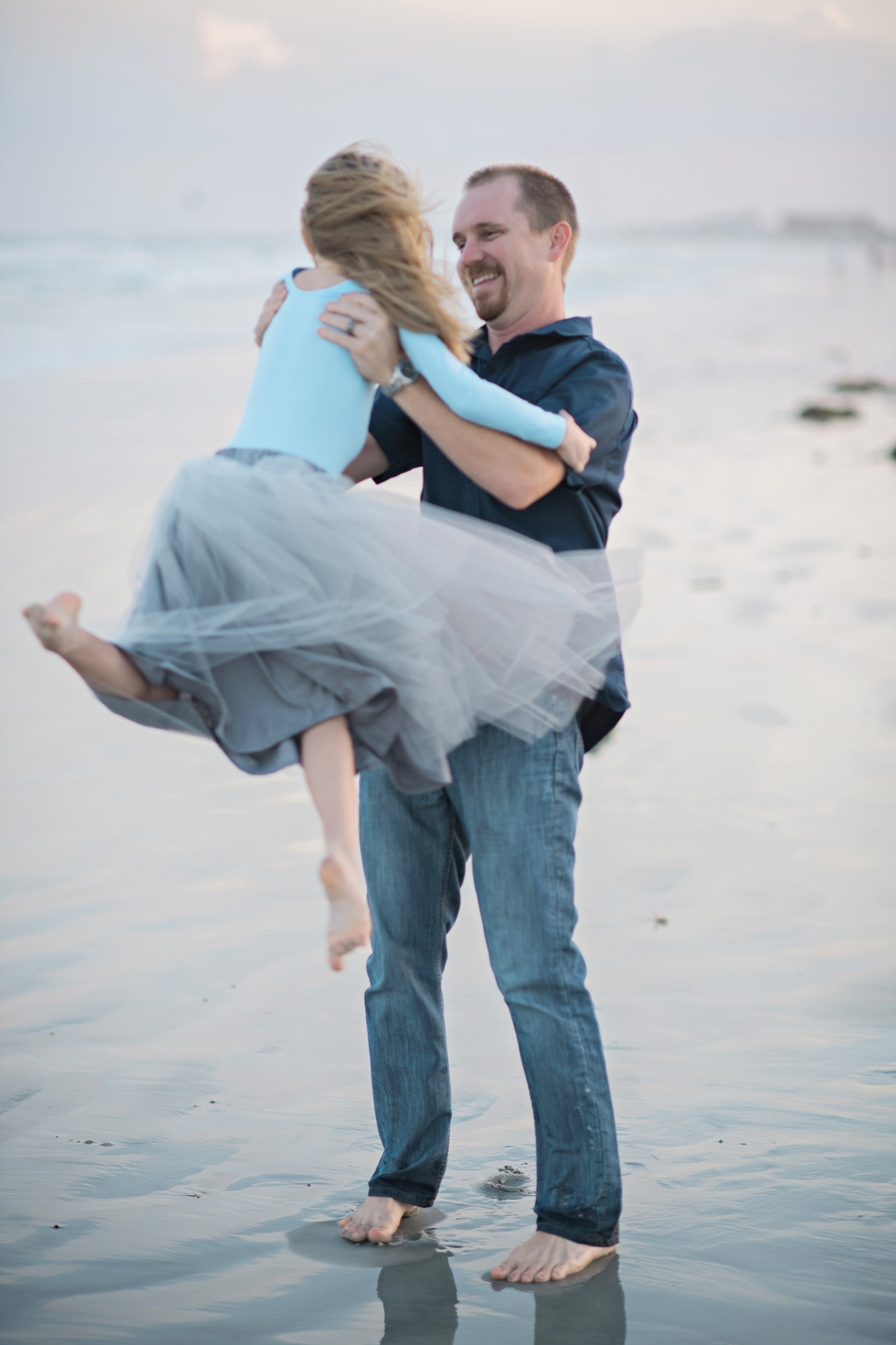 Dad and daughter on the beach