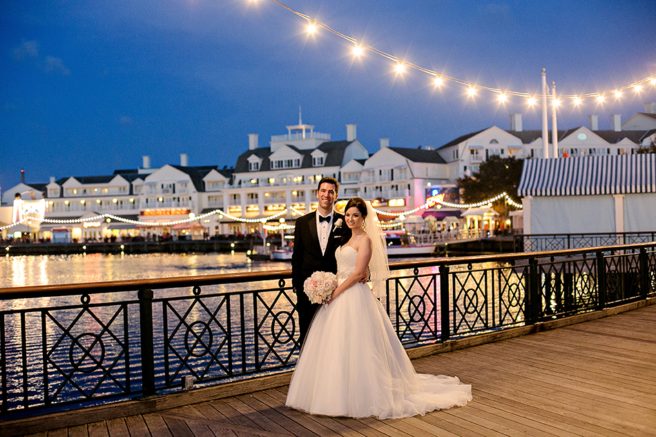 Disney's Boardwalk Resort at dusk - Bride and groom on the Boardwalk