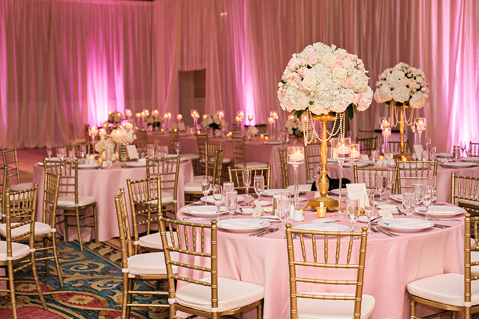 Pink and gold luxury ballroom reception at the Boardwalk Resort in Disney
