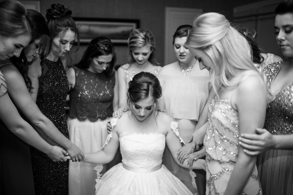prayer with bridesmaids