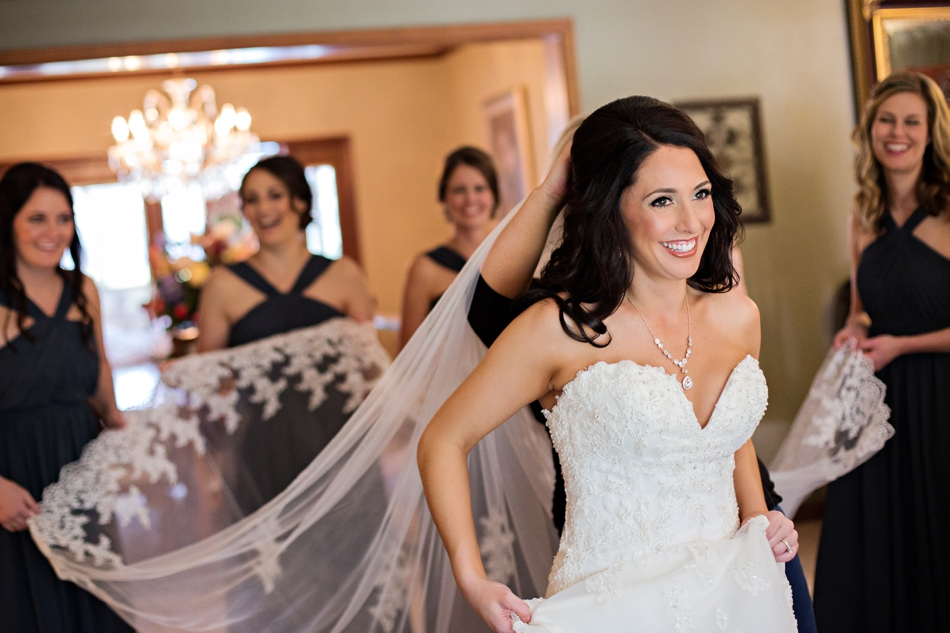 bride gets dressed at her home