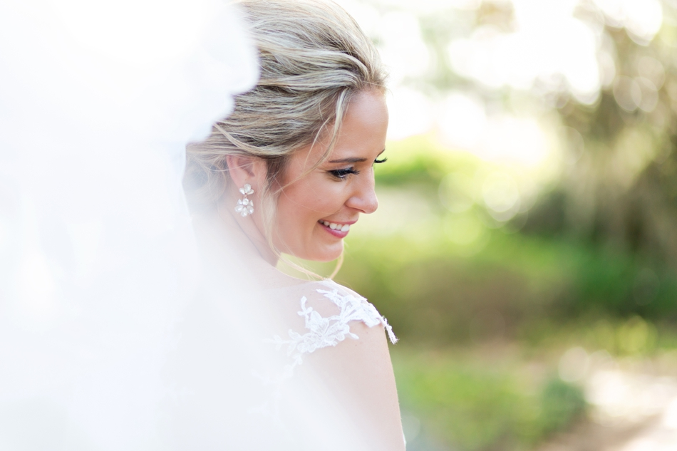 Smiling at the ground for bridal portraits