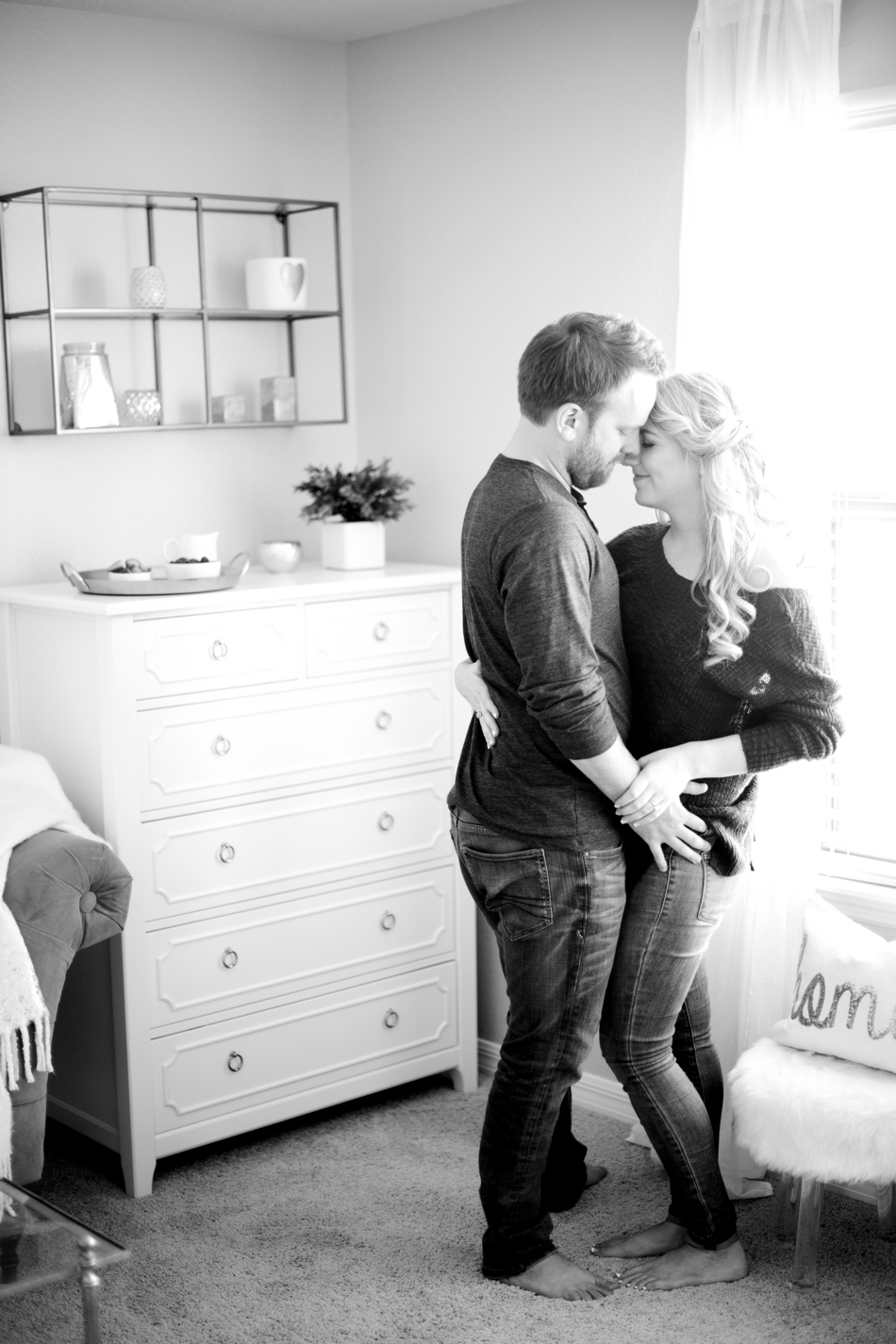 black and white engagement photos at home