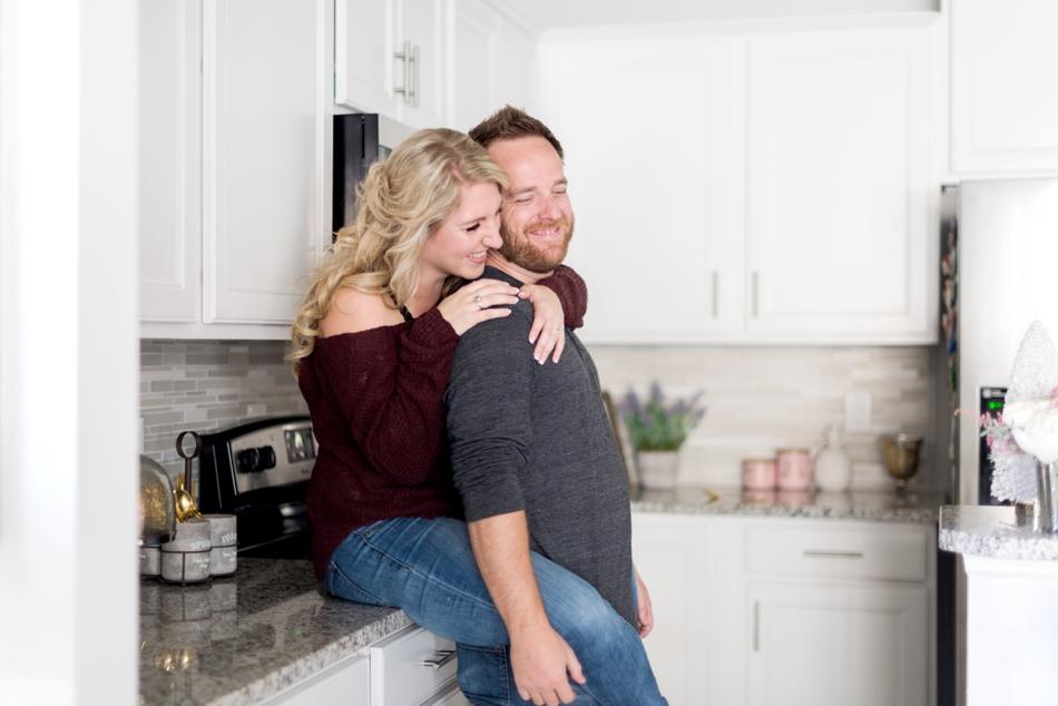cuddling in kitchen