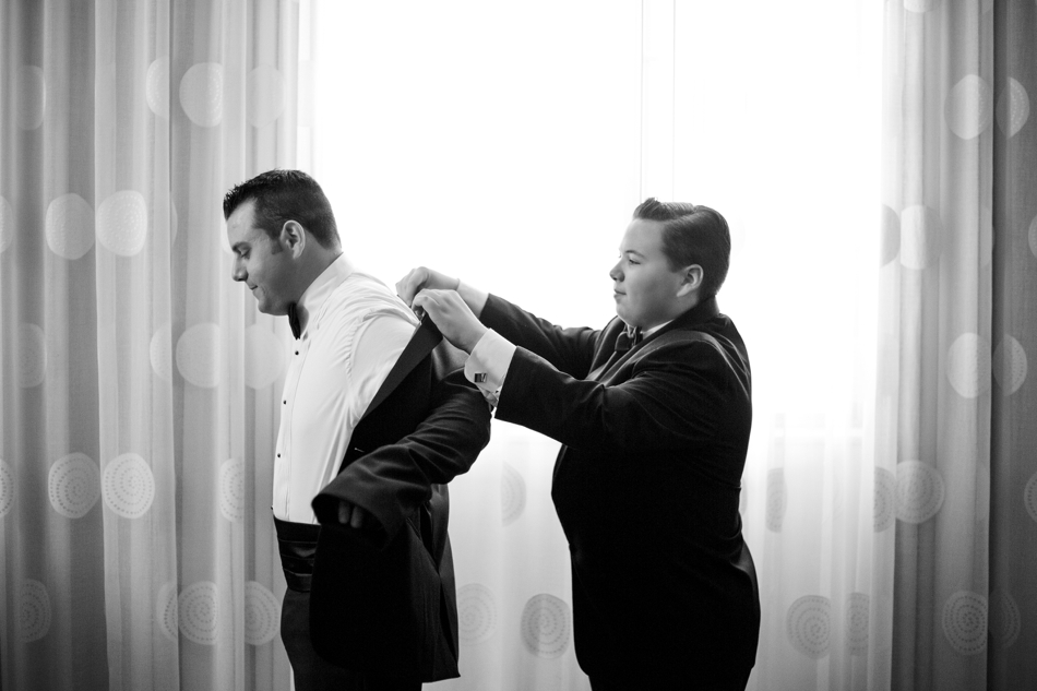 best man helping the groom get ready