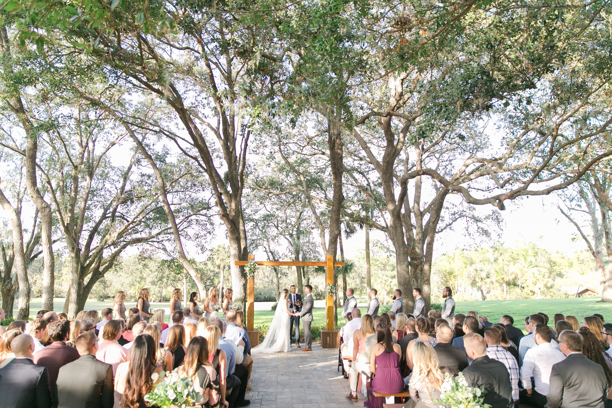 outdoor wedding ceremony in woods in florida