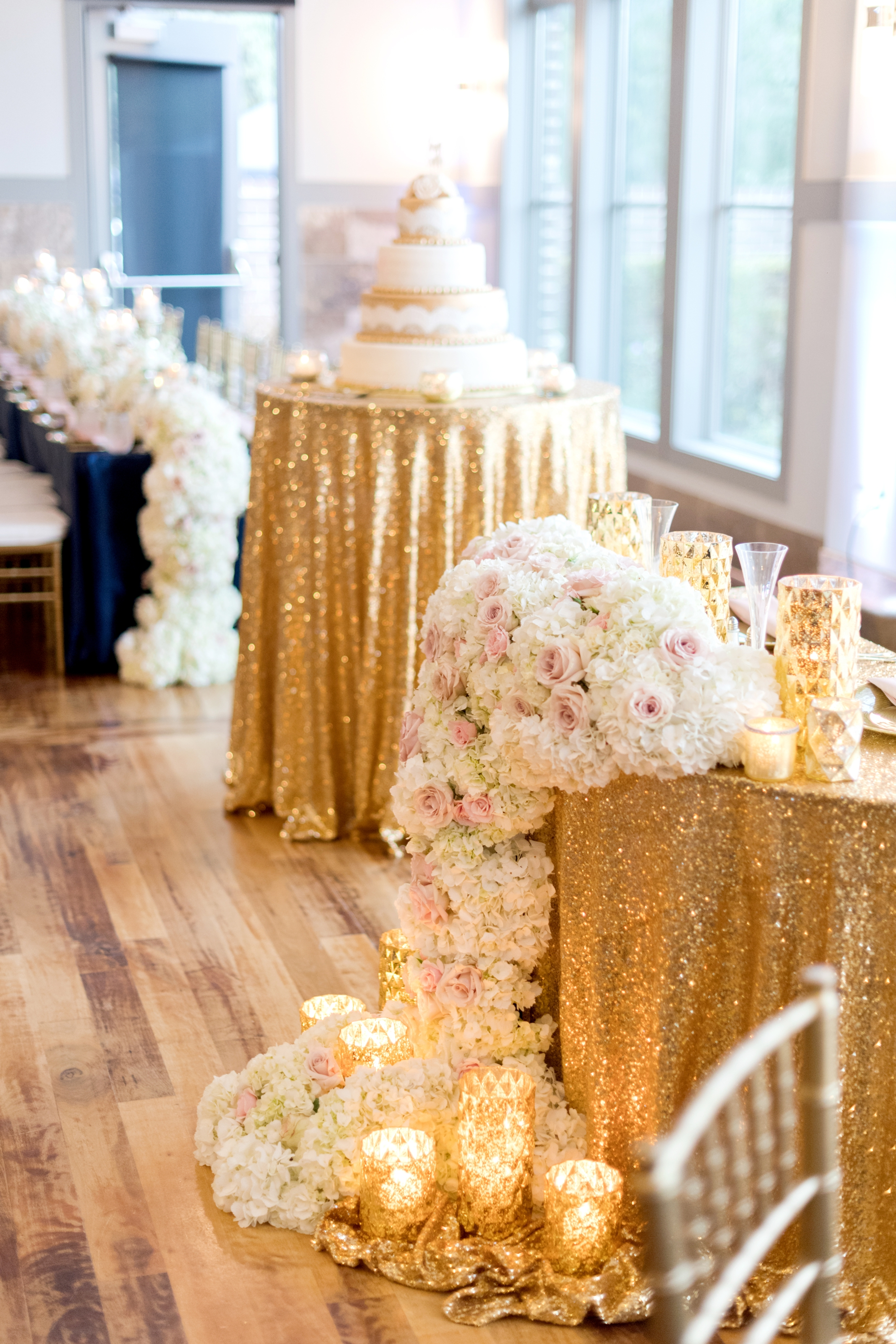 gold reception with lots of flowers