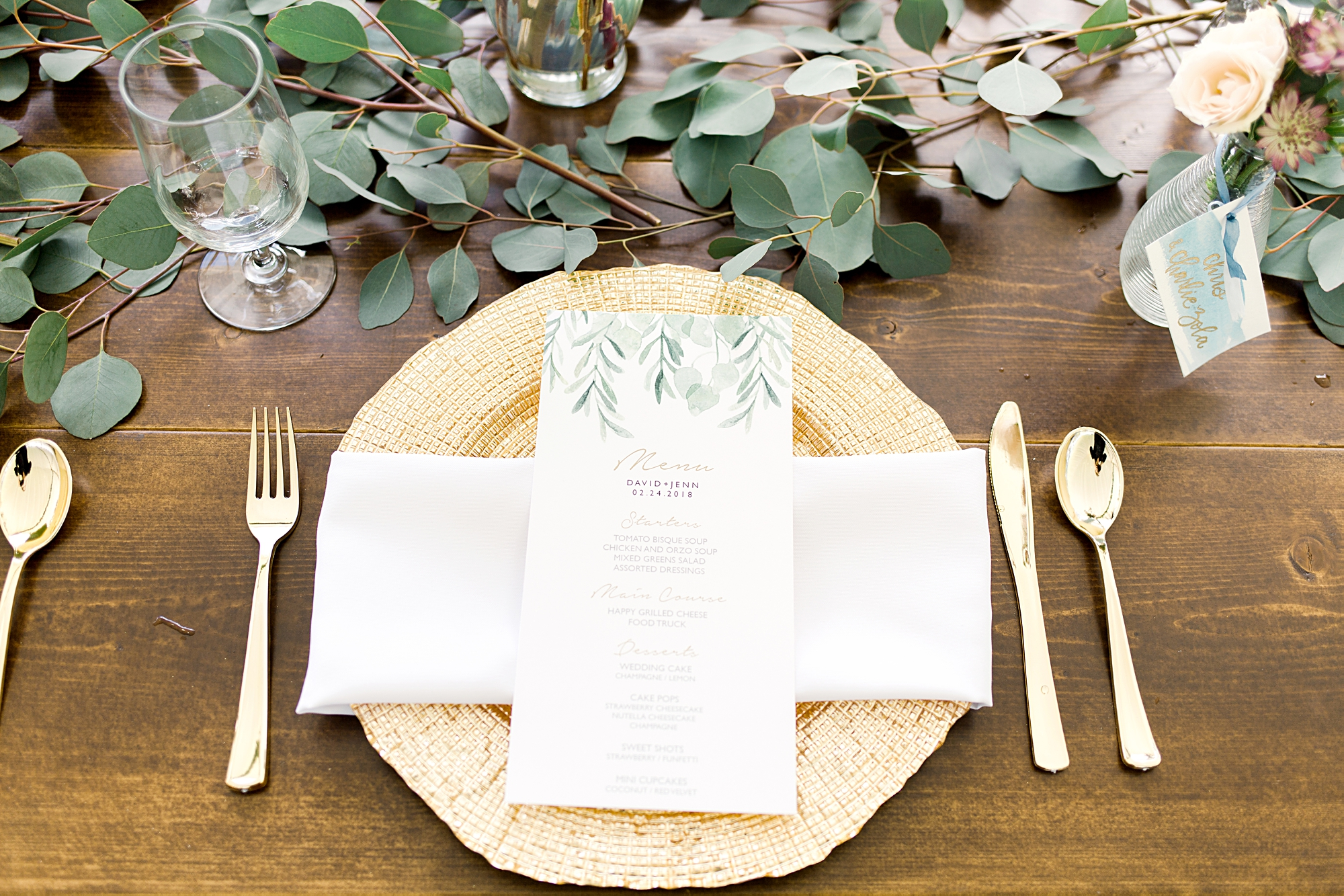 gold flatware and farmwood table reception decor