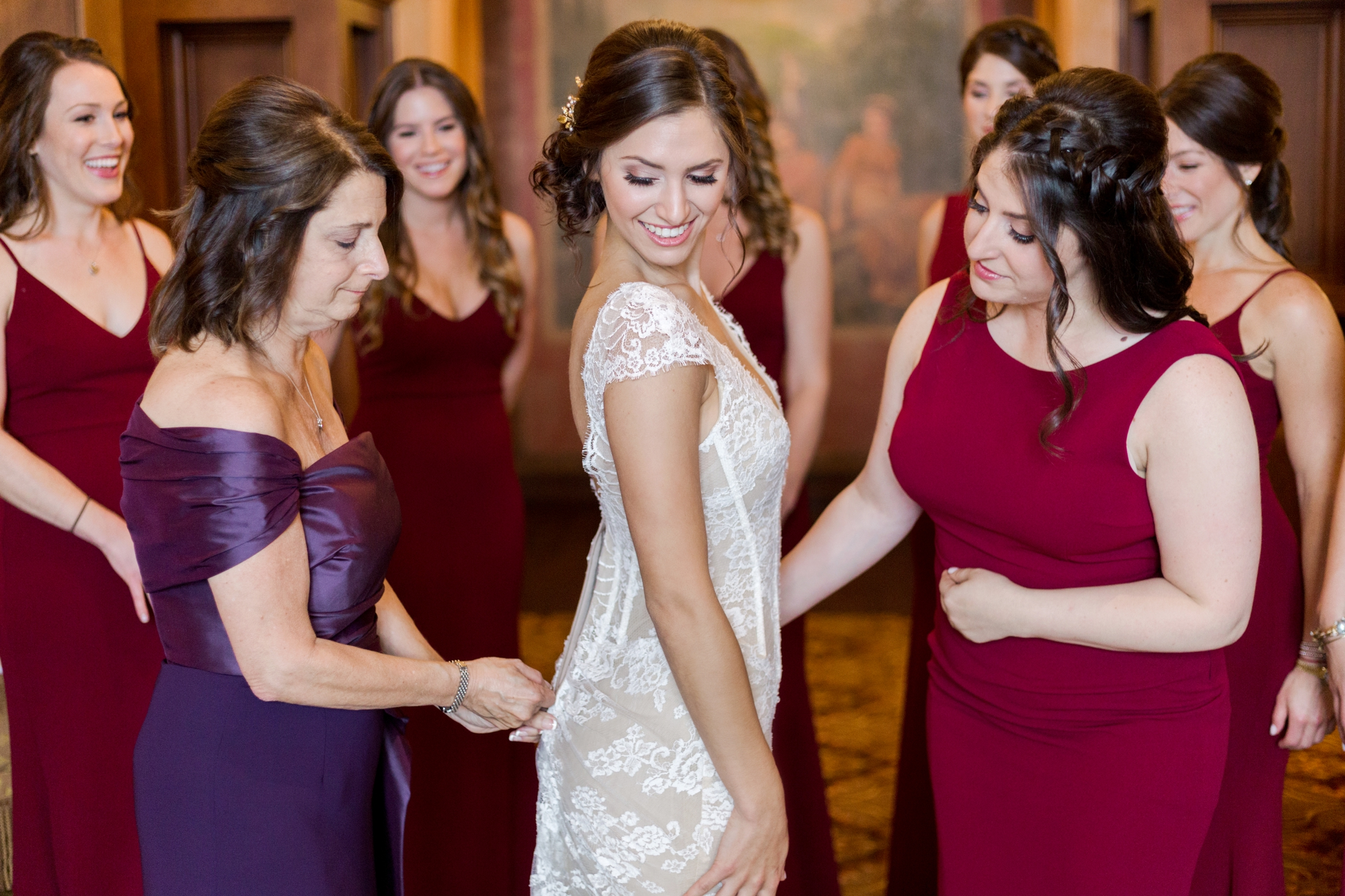 mom zips up bride