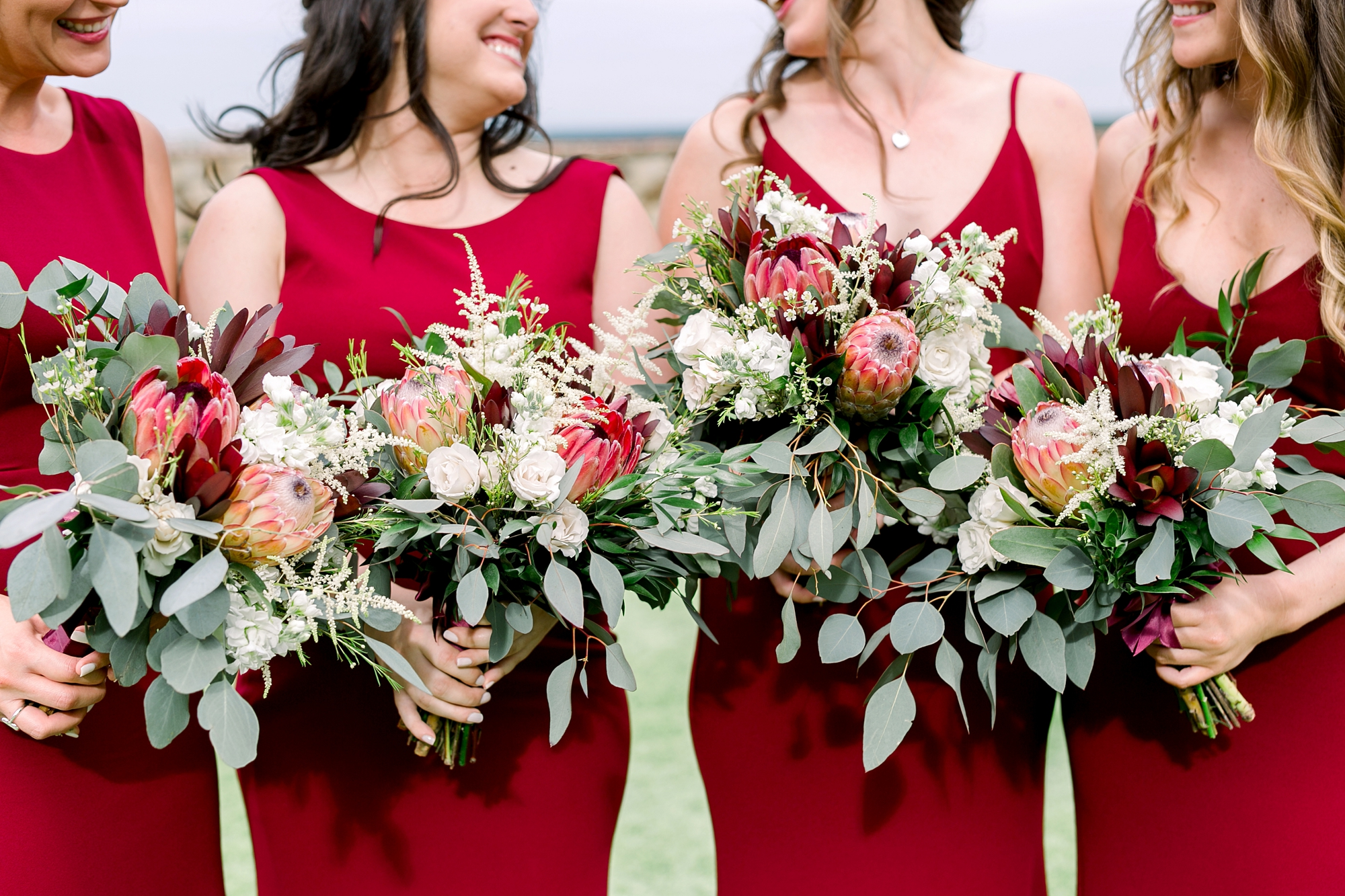 gorgeous bridesmaid bouquets by raining roses productions