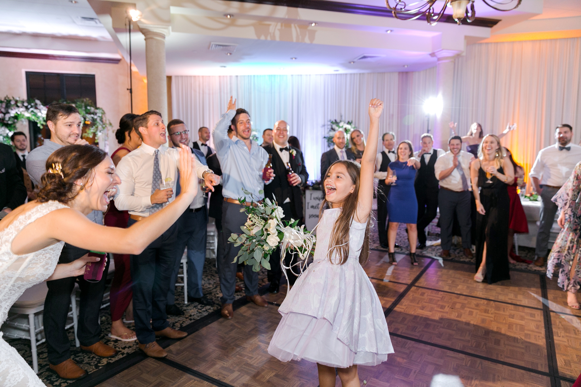 flower girl catches the bouquet