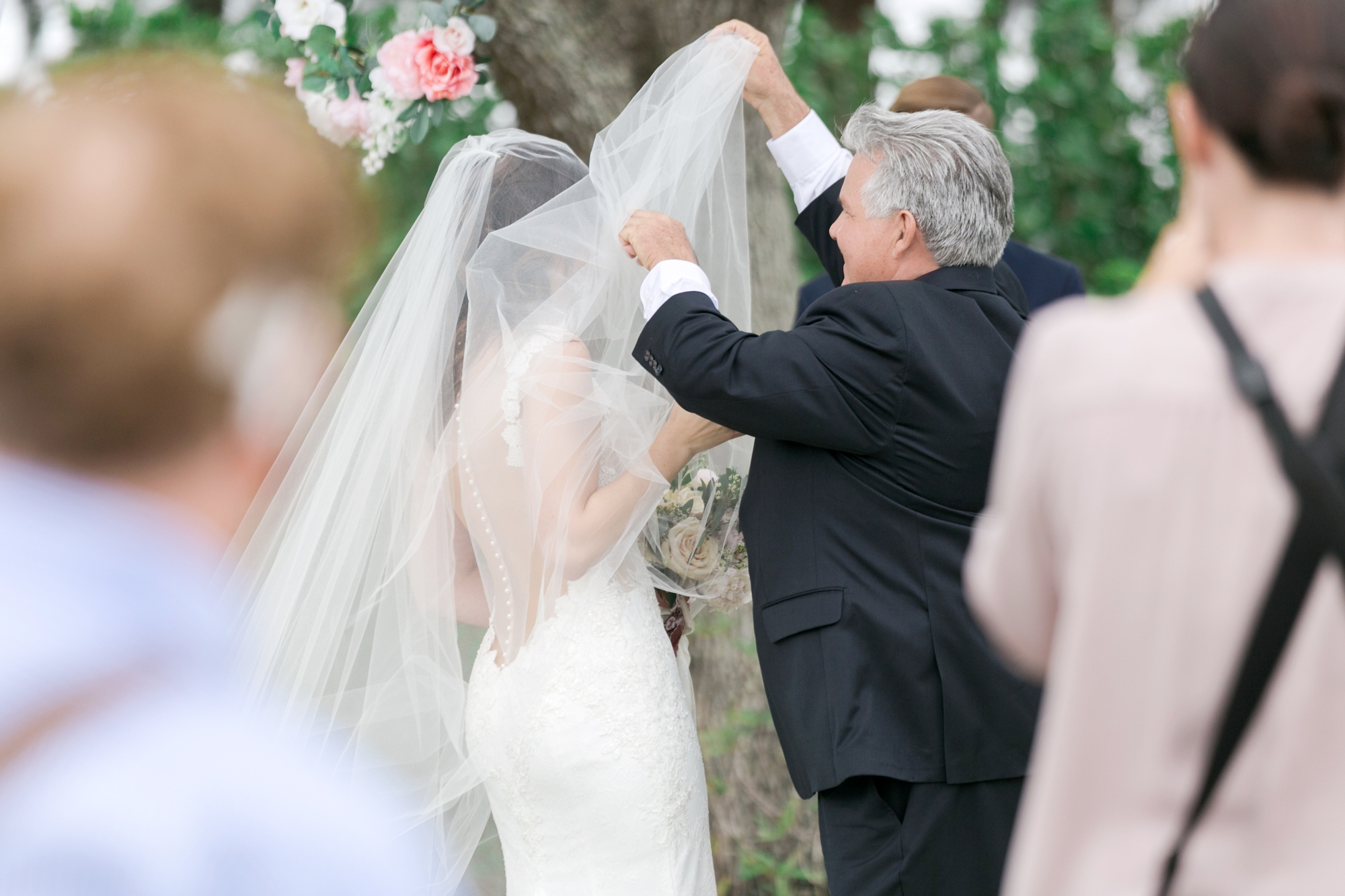 dad lifting veil for bride