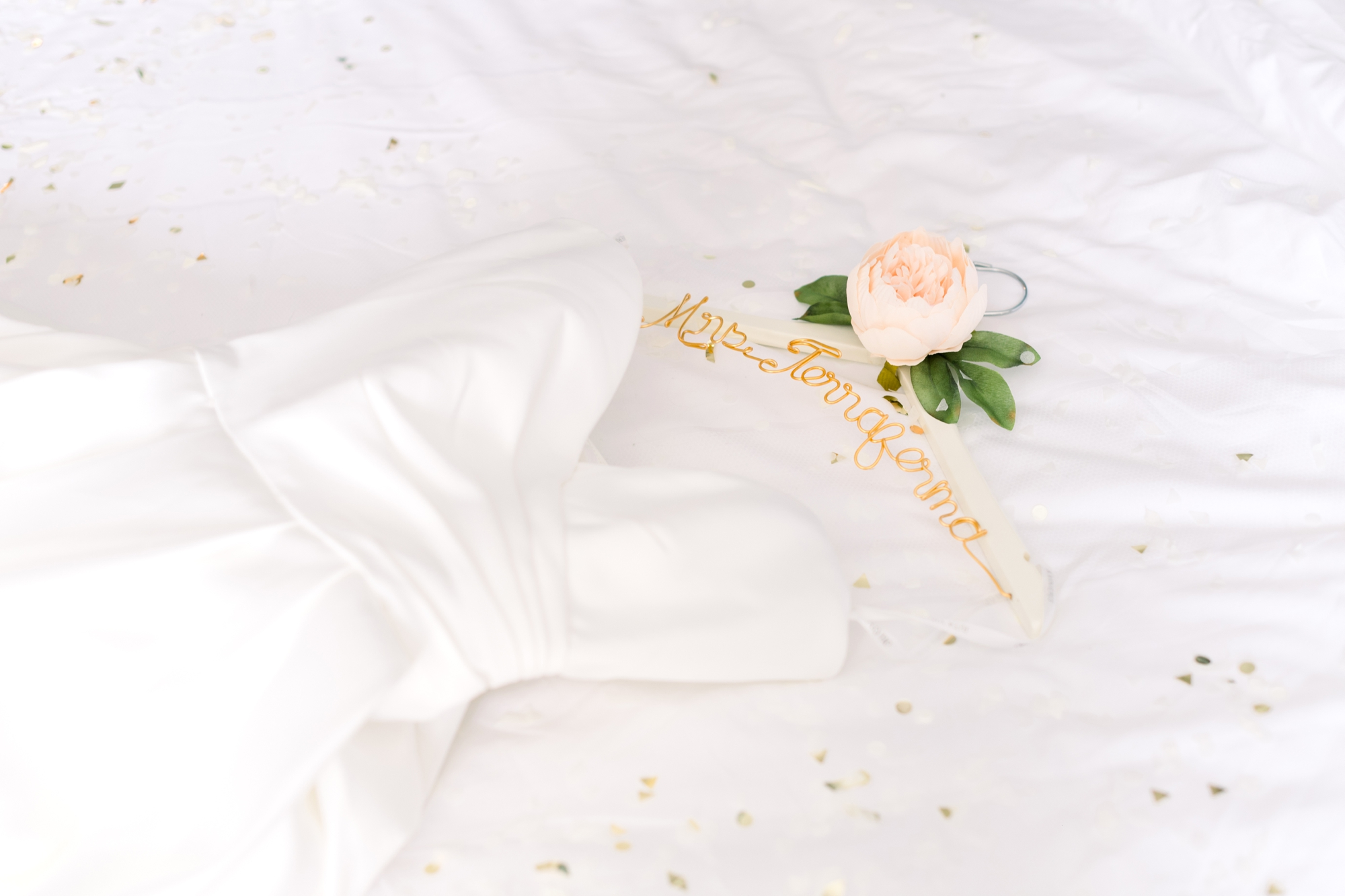Gold and white bride hanger with flower
