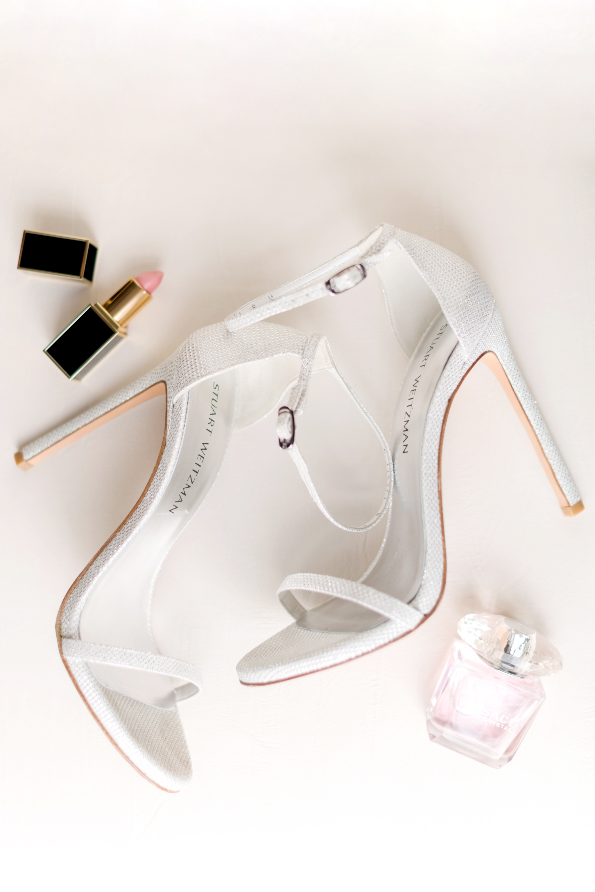 bridal details - Stuart Weitzman shoes, tom ford lipstick and versace perfume