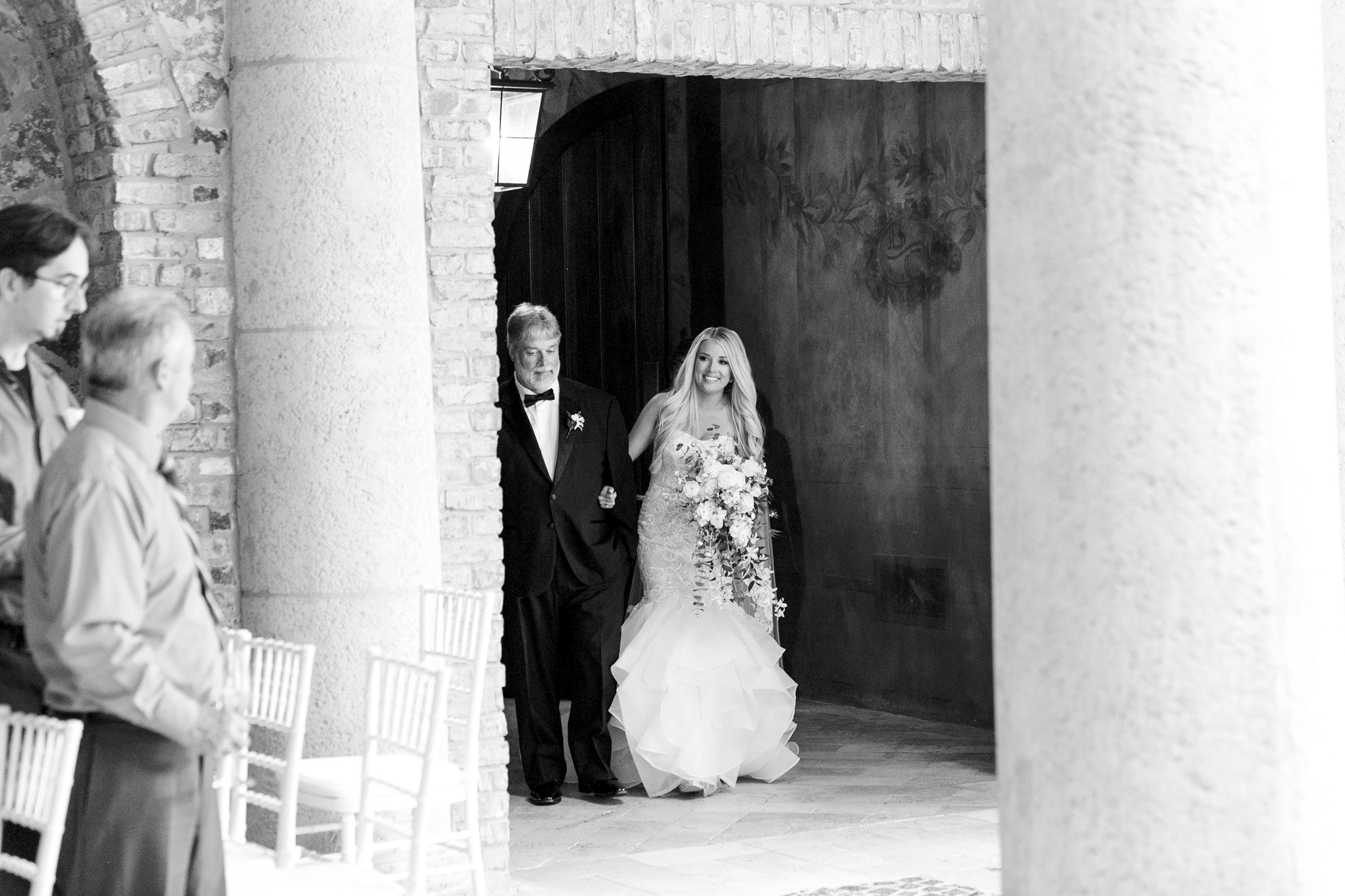 bride walking down isle with father