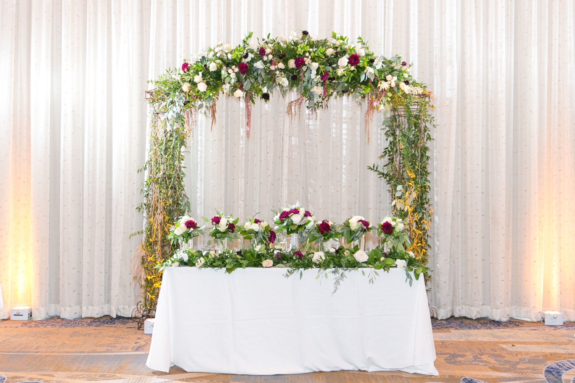 arch at head table wedding reception