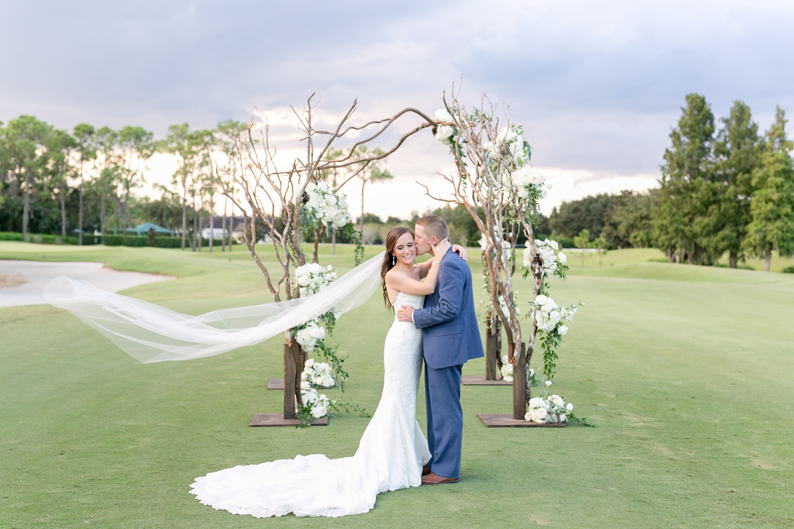 branch chuppah with flowers