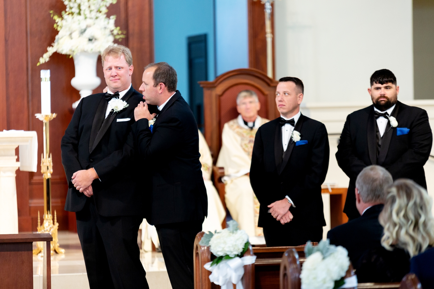 groom cries at aisle