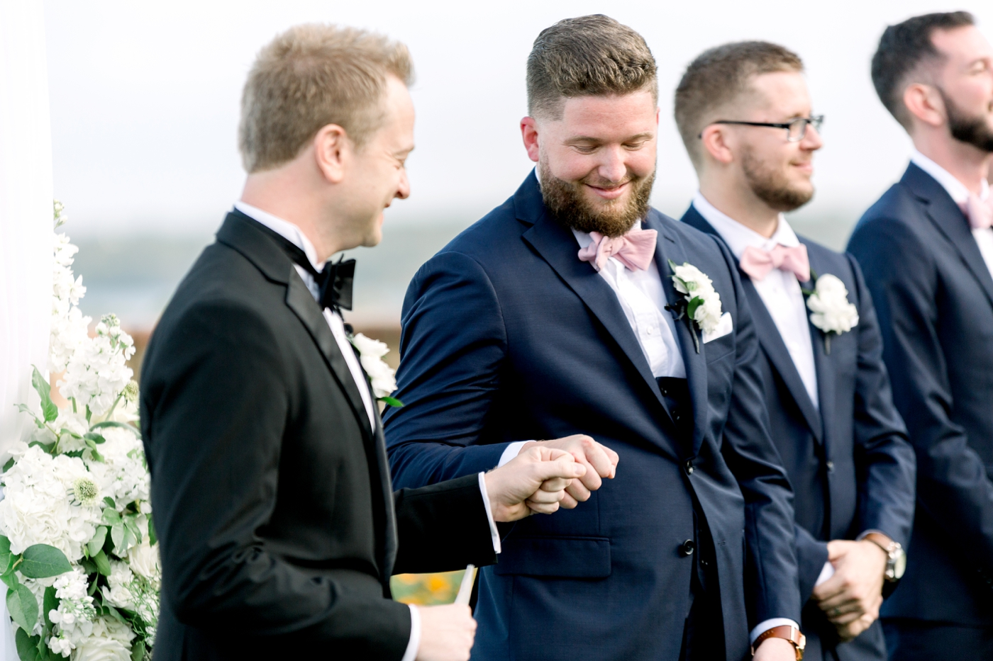 groom fist bump as bride walks down aisle