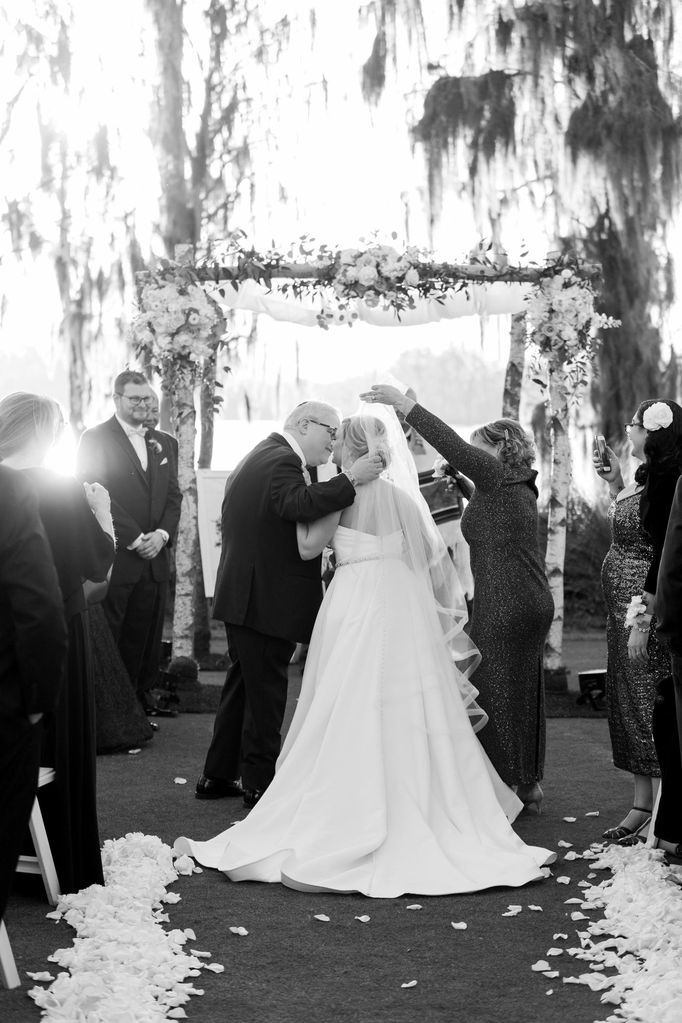 bride kissing dad under veil